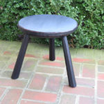 carved-edge milking stool