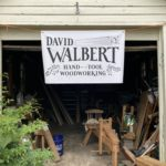 Workshop with booth sign: David Walbert Hand Tool Woodworking
